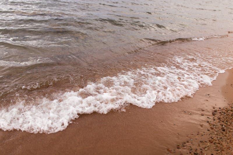 Sandy shore of the sea as a backdrop stock photos