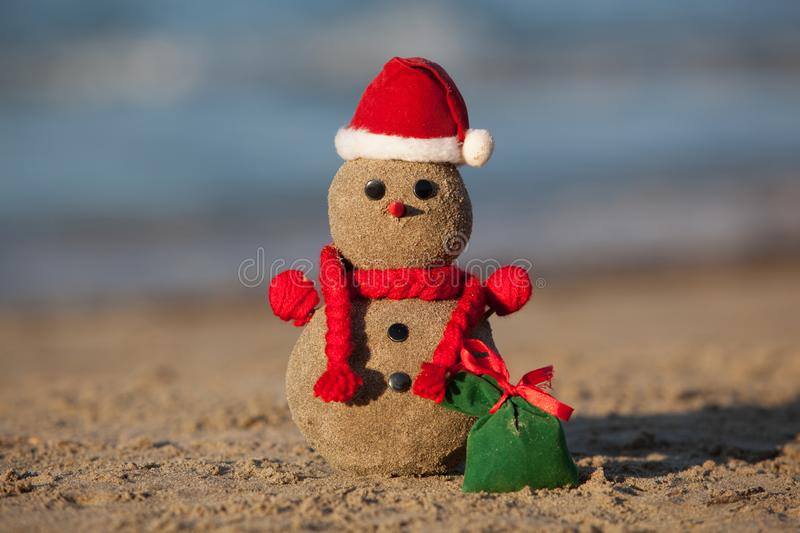 Sandy snowman at tropical beach. royalty free stock image