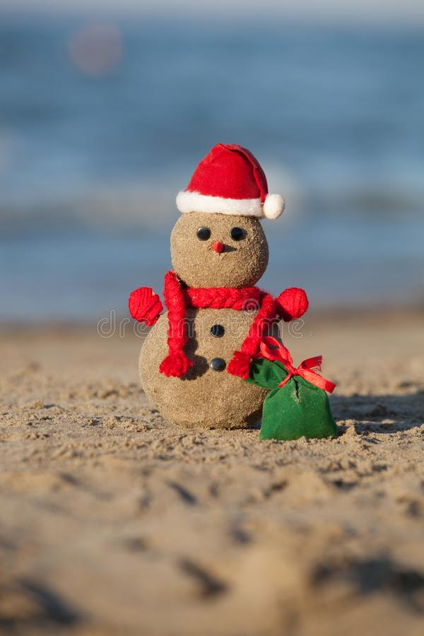 Sandy snowman at tropical beach. royalty free stock images