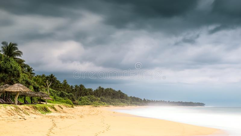 Sandy tropical beach with long exposure stock photography