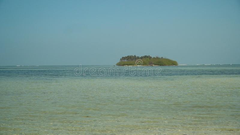 Sandy white beach. Philippines. Tropical island with white sandy beach, palm trees in blue lagoon. Tanduyong island with turquoise water. Seascape, ocean and royalty free stock photos