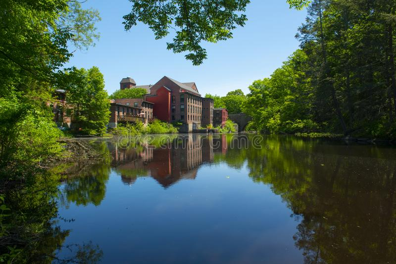 Sanford Mill, Medway, Massachusetts, USA. Sandford Mill on Charles River in Medway historic town center in summer, Medway, Boston Metro West area, Massachusetts royalty free stock photo