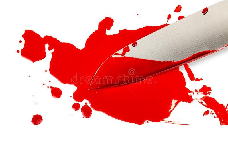 Sang et couteau photographie stock