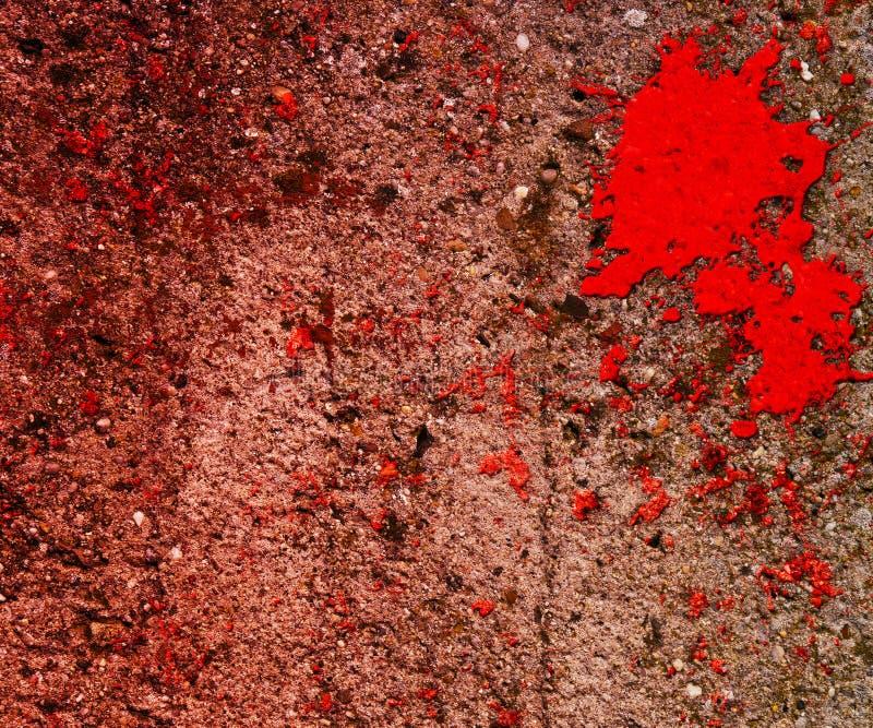 Sang rouge sur le mur grunge photos stock
