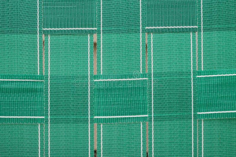 Sangle de chaise de jardin tissée par vert image libre de droits