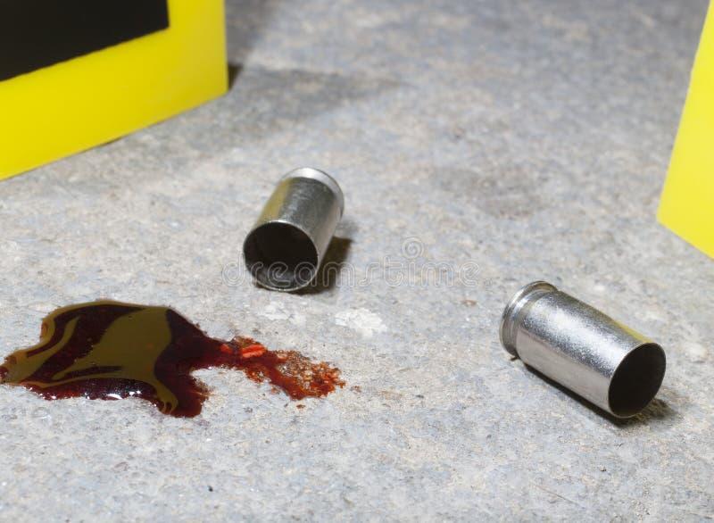 Sangre y munición fotografía de archivo