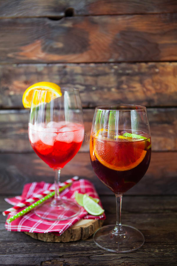 Sangria and ingredients in glasses on a rustic wood royalty free stock photography