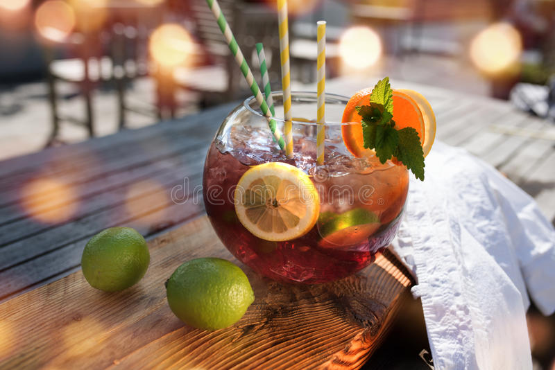 Sangria or punch with fruit. On a wooden table in a restaurant and bokeh royalty free stock photography