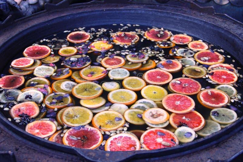 Sangria. Sbiten Punch Drink homemade. Slices of fresh orange, bright lemon, grapefruit, honey and spices stock images