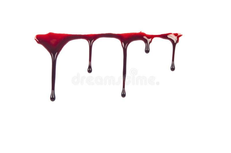 Sangue della sgocciolatura isolato su bianco immagini stock