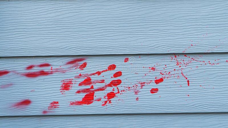 Sangue na parede, conceito da violação do assassino do crime do Dia das Bruxas imagem de stock royalty free