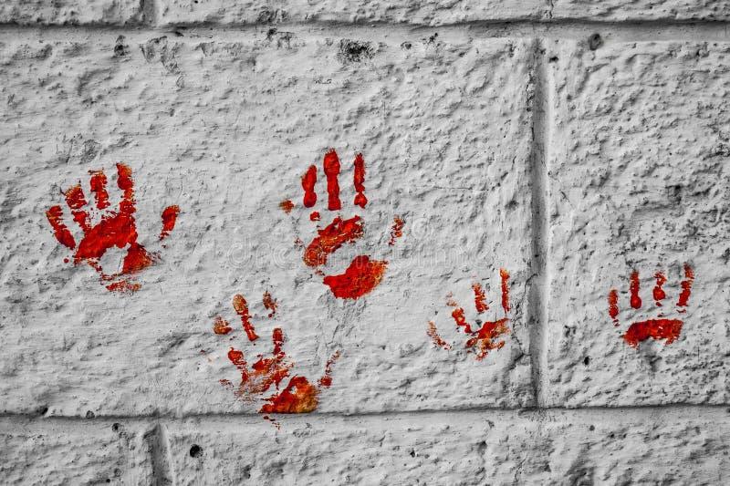 Sanguinoso sullo sguardo del muro di mattoni molto spaventoso e terrificante fotografia stock libera da diritti