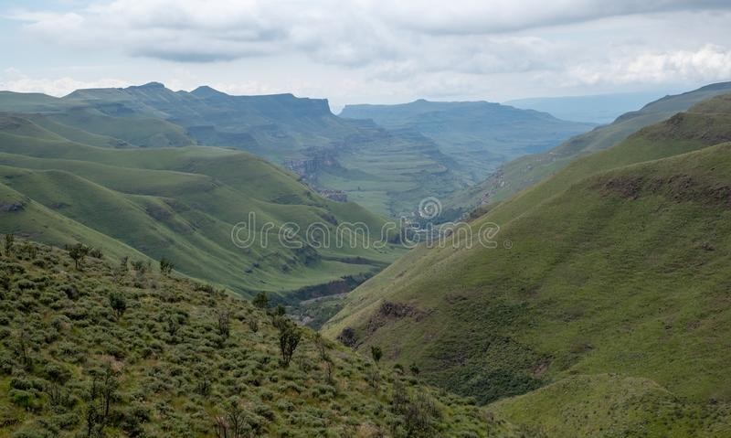 View of the Sani Pass, dirt rural road though the mountains which connects South Africa and Lesotho. stock photography