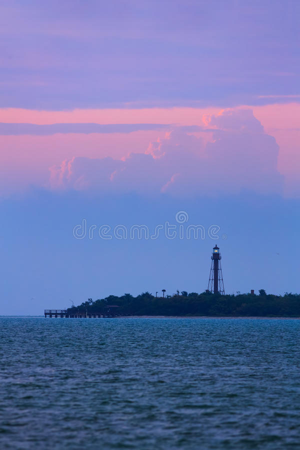 Sanibel Island Lighthouse Dawn. A dramatic and colorful sky silhouettes the shining beacon atop the metal tower of the Sanibel Island Lighthouse on Florida Gulf stock images