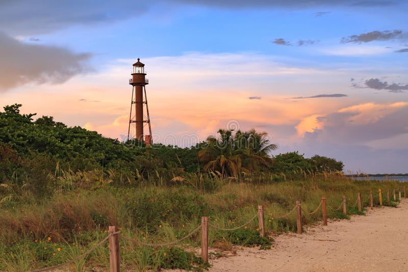 Sanibel Island Lighthouse, Sanibel Island, Florida, USA. The Sanibel Island Lighthouse is framed against the late light from the setting sun stock photos