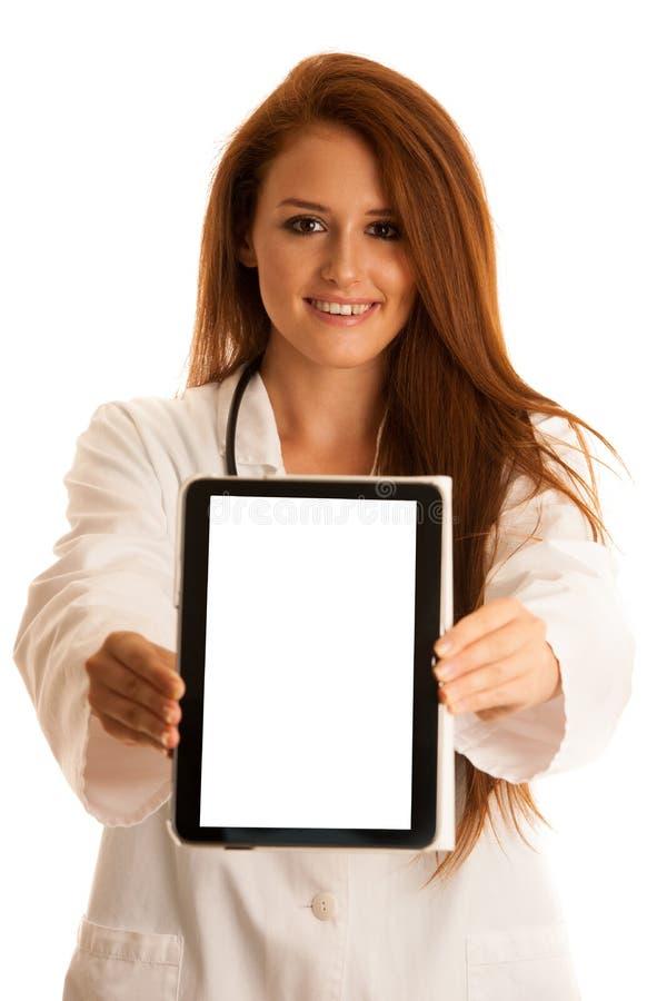 Sanità e medicina - medico della giovane donna isolato sopra briciolo immagine stock