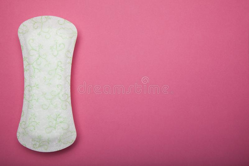 Sanitary napkins or pad, on pink background. Copy space.  stock images