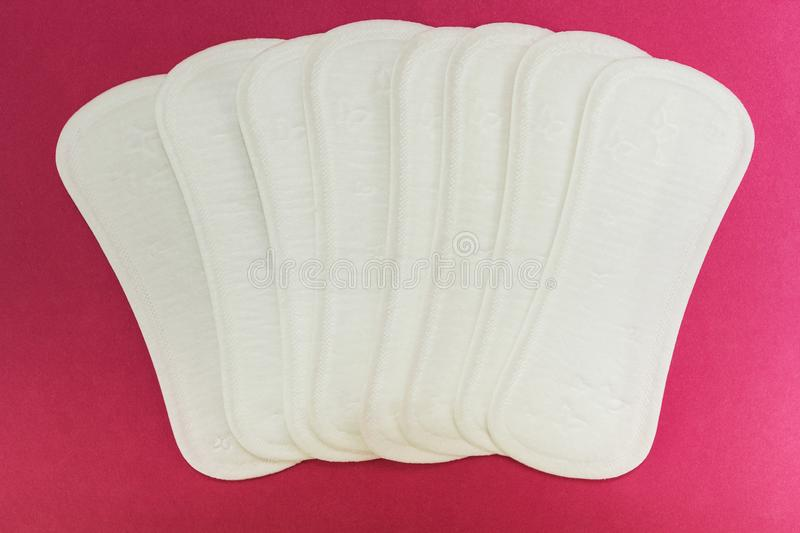 Sanitary pads on a pink background.  royalty free stock images