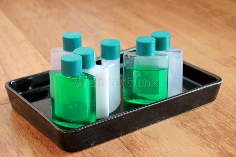 Sanitary ware set tray in bathroom. Sanitary ware set tray on plank floor in the bathroom stock image