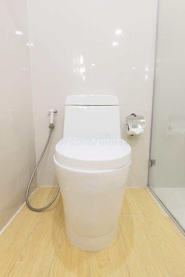 Sanitary ware. White sanitary ware in modern toilet royalty free stock image