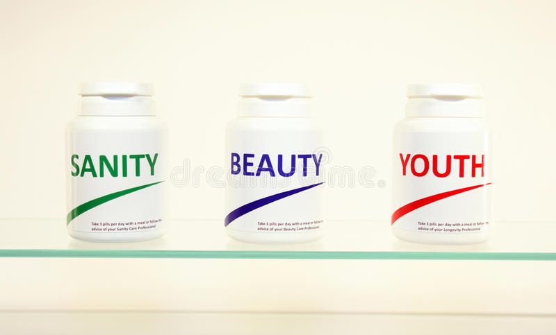Download Sanity, Beauty And Youth Pills In A Bottle Royalty Free Stock Photography - Image: 14944897