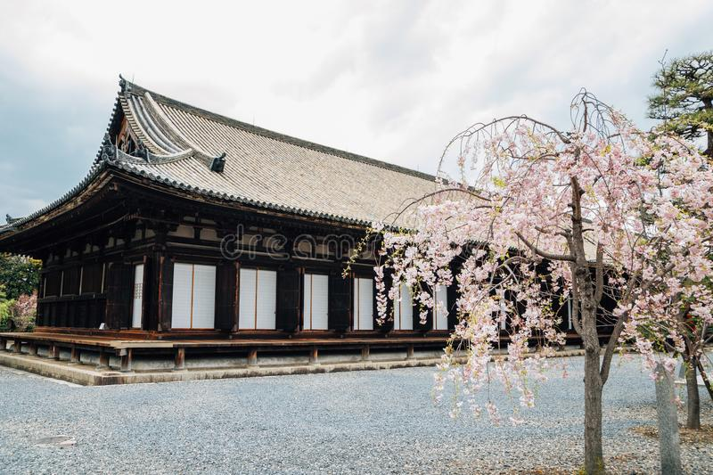 Sanjusangendo Temple with cherry blossom in Kyoto, Japan. Sanjusangendo Temple with cherry blossoms in Kyoto, Japan royalty free stock photo