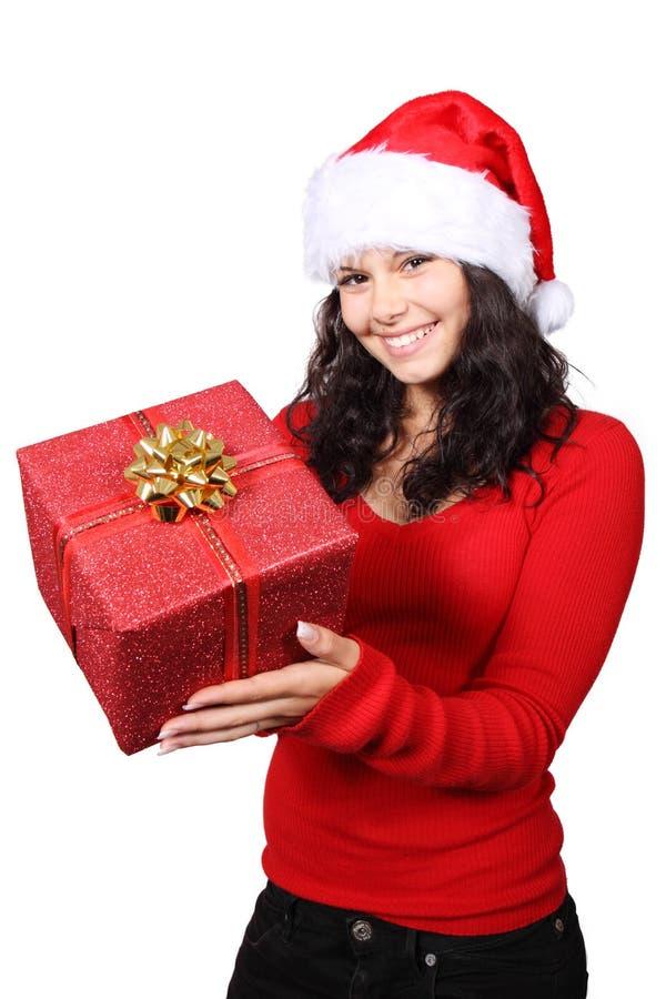 Sankt, die ein Weihnachtsgeschenk übergibt stockbild