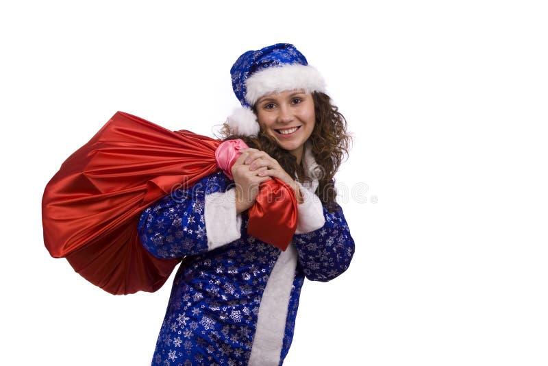 Sankt-Frau hält roten Sack mit Geschenken an. lizenzfreie stockbilder