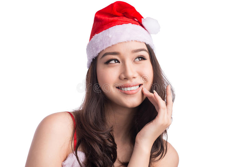 Sankt-Frauen mit Beuteln Schönheit asiatisches vorbildliches Girl in Santa Hat Thinking S lizenzfreie stockfotos