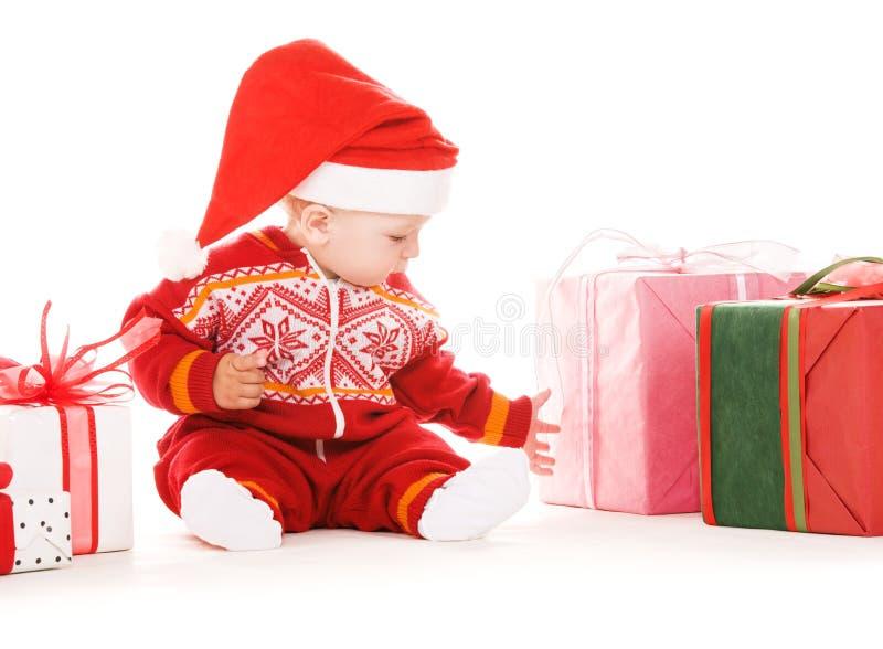 Sankt-Helferschätzchen mit Weihnachtsgeschenken stockfotografie