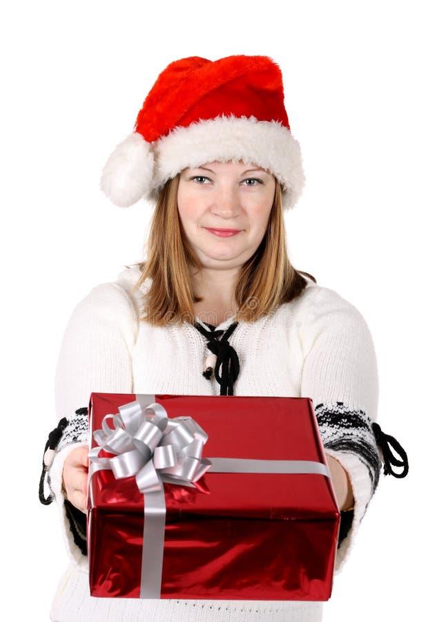 Sankt-Mädchen, das ein Geschenk gibt stockfotos