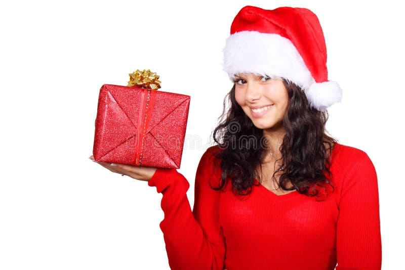 Sankt-Mädchen, das ein Weihnachtsgeschenk anhält stockfotos