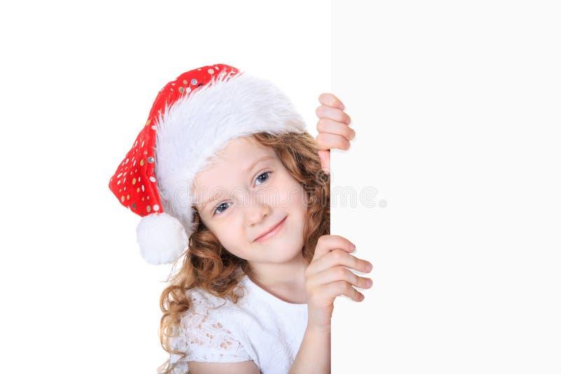 Sankt-Mädchen im roten Hut mit leerem weißem Brett lizenzfreie stockfotografie