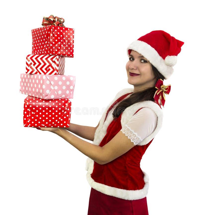 Sankt-Mädchen mit Stapel von Geschenken stockfotos
