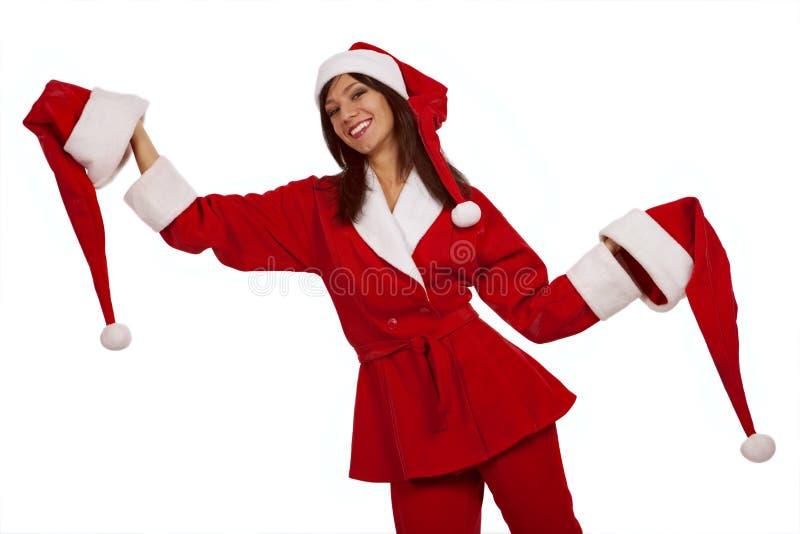 Sankt-Mädchen mit zwei Weihnachtshüten stockfoto