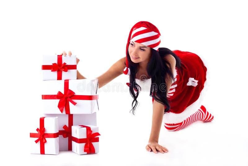 Sankt-Mädchen seine Hände auf Geschenke. stockfoto