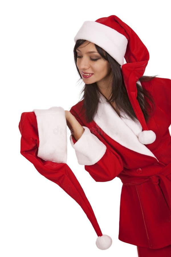Sankt-Mädchenaufruf an Weihnachtshut stockfotografie