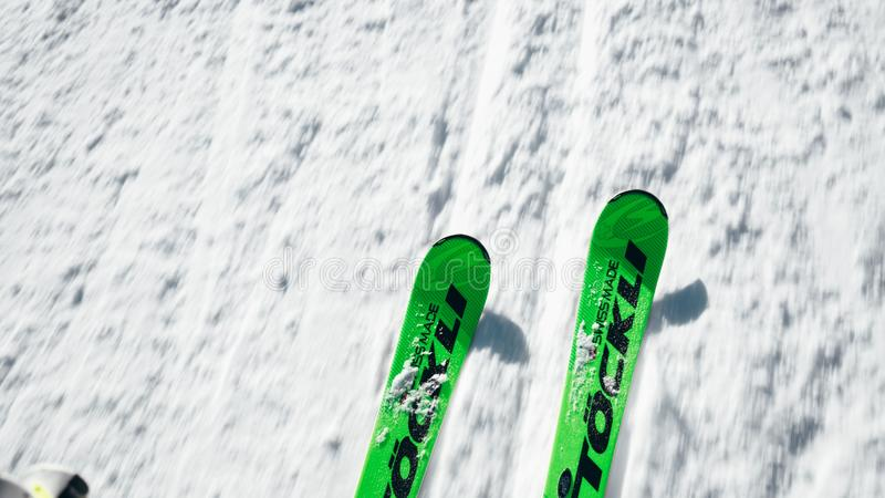 High angle shot of green ski on a snowy surface royalty free stock photo