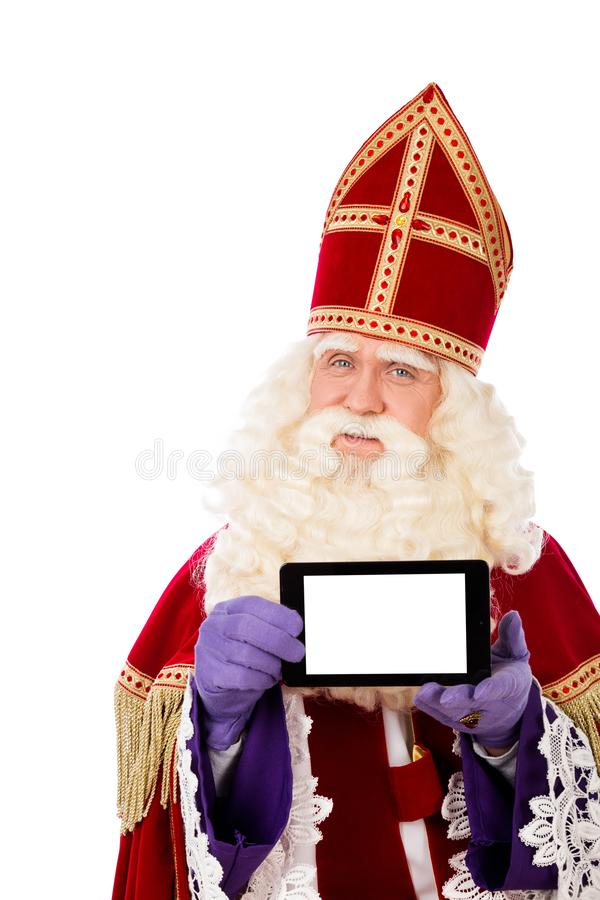 Sankt Nikolaus mit Tablette oder intelligentem Telefon stockbild