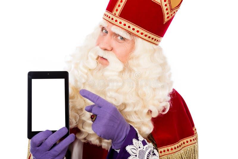 Sankt Nikolaus mit Tablette oder intelligentem Telefon lizenzfreie stockfotos