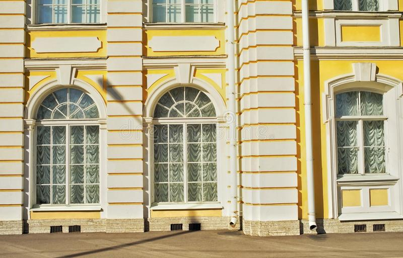 Sankt-Petersburg architecture historical building windows yellow wall sunlight outdoor travel. Sankt-Petersburg architecture details windows yellow wall stock photos