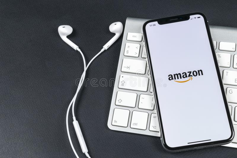 Amazon shopping application icon on Apple iPhone X screen close-up. Amazon shopping app icon. Amazon mobile application. Social me. Sankt-Petersburg, Russia royalty free stock photo
