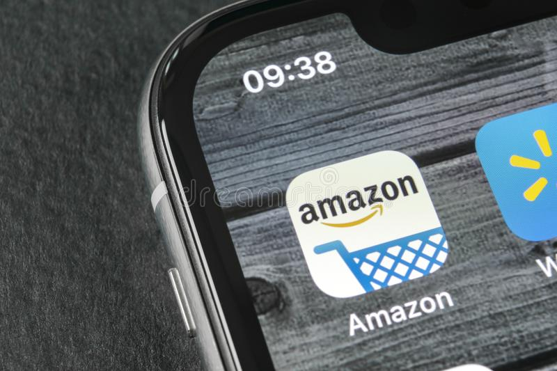 Amazon shopping application icon on Apple iPhone X screen close-up. Amazon shopping app icon. Amazon mobile application. Social. Sankt-Petersburg, Russia, April stock photography