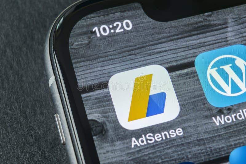 Google AdSense application icon on Apple iPhone X screen close-up. Google AdSense app icon. Google AdSense application. Social. Sankt-Petersburg, Russia, April stock image