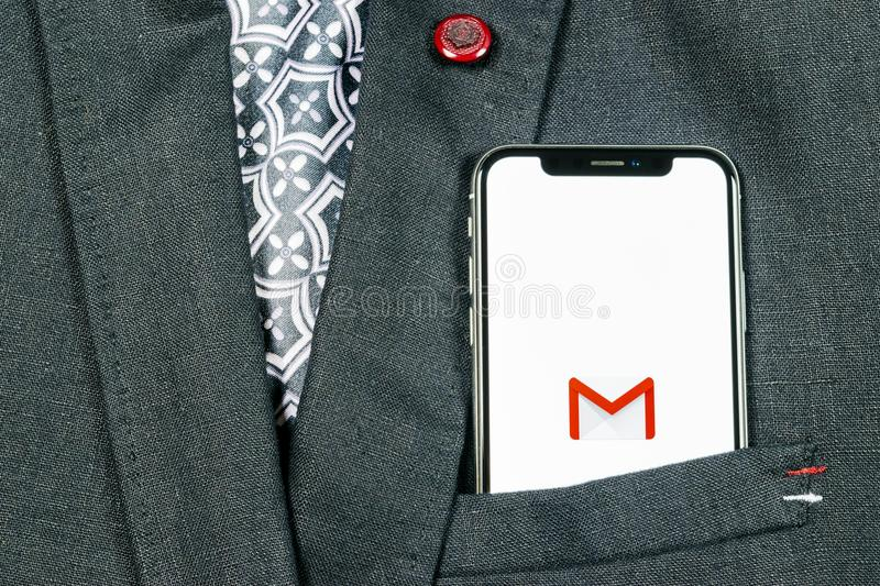 Google Gmail application icon on Apple iPhone X smartphone screen close-up in jacket pocket. Gmail app icon. Gmail is popular Int. Sankt-Petersburg, Russia stock photos