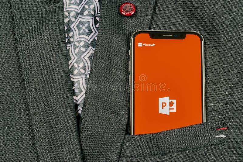 Microsoft office Powerpoint application icon on Apple iPhone X screen close-up in jacket pocket. PowerPoint app icon. Microsoft P. Sankt-Petersburg, Russia royalty free stock photo
