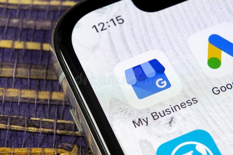 Google My Business application icon on Apple iPhone X screen close-up. Google My Business icon. Google My business application. So royalty free stock photos