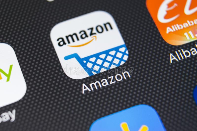 Amazon shopping application icon on Apple iPhone X screen close-up.Amazon shopping app icon. Amazon mobile application. Social. Sankt-Petersburg, Russia royalty free stock photo