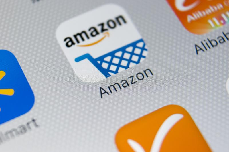 Amazon shopping application icon on Apple iPhone X screen close-up. Amazon shopping app icon. Amazon mobile application. Social. Sankt-Petersburg, Russia stock photography
