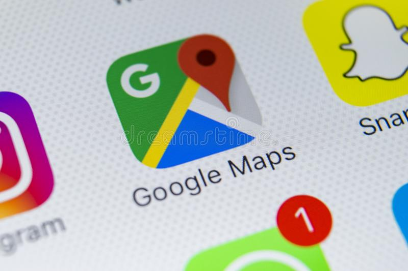 Google Maps application icon on Apple iPhone X screen close-up. Google Maps icon. Google maps application. Social media network stock photography